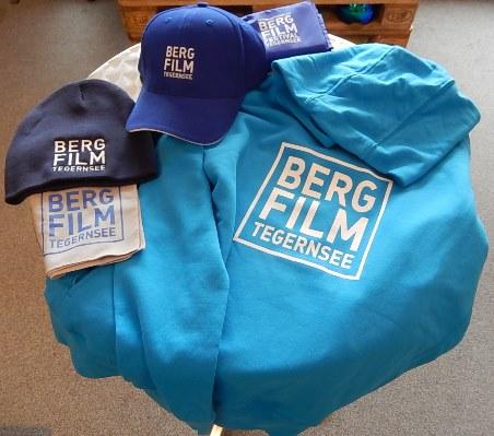 Fanartikel zu Bergfilm Tegernsee: Beanies, Hoodies, Caps, Mikrofaserhandtuch und Sitzkissen